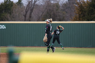 Softball vs. UAM (green pants by Maddie Boepple, black pants by Emily Dicus)
