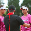 Georgia infielder Lacey Sumerlin (25) and Georgia infielder Alyssa DiCarlo (8) talk with Georgia assistant coach Tony Baldwin during an NCAA softball game between Georgia and Ole Miss at Jack Turner Stadium on April 30, 2016 in Athens, Ga. (Photo by Emily Selby)