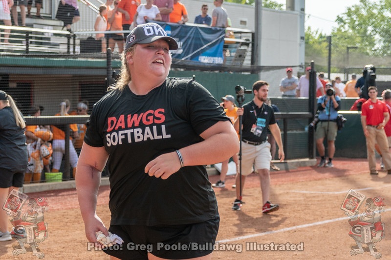 Injured pitcher Brittany Gray celebrates. The evidence of her recent surgery visible on her right arm.