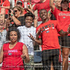 Basketball point guard Taja Cole and football wide receiver Mecole Hardman celebrate in the stands
