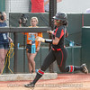 Cortni Emanuel rounds third base after home run
