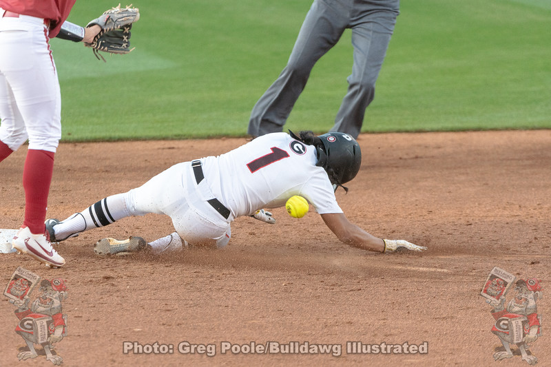 Cortni Emanuel stealing second successfully.