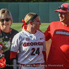Kylie Bass and her parents during pregame Senior Day Ceremonies