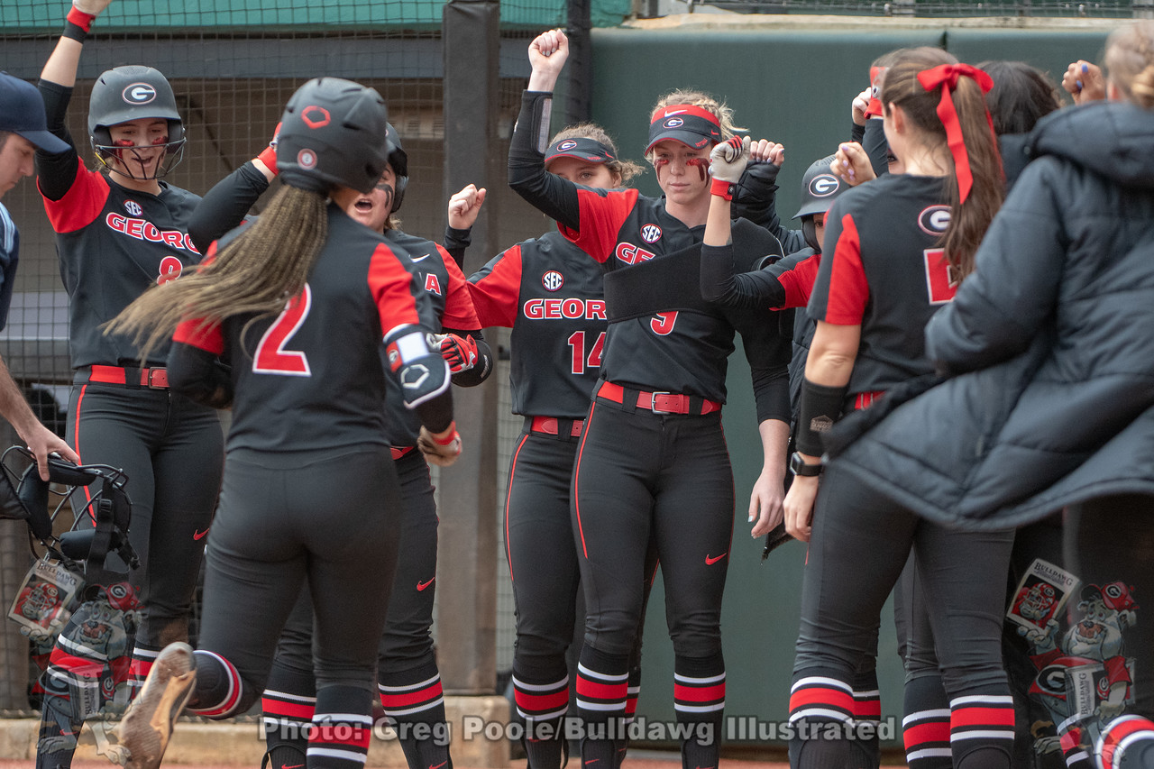 UGA softball infielder Justice Milz is greeted at home plate during the 2019 Red and Black Showcase