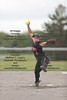 McComb's Shelby Steinbrook (6) winds and delivers a pitch against Arcadia.