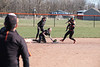 McComb's shortstop Malorie Schroeder (15) crawls to second base to get the force out NB's Paige Hyatt (3) after diving and fielding a groundball.