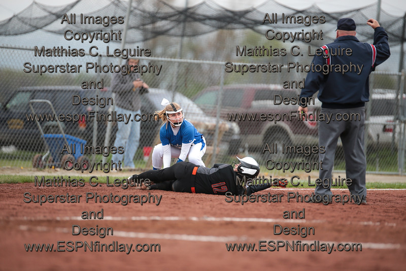 Riverdale's third baseman, Brooke Kuenzlie (9), looks to the umpire as VB's Brylie Rampe (12) lays in the dirt with her foot on the bag.  Rampe was called out as she tried to stretch a double into a triple and was tagged out sliding into third base by Riverdale's Brooke Kuenzli (9).