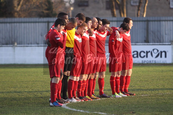 Teams observe a minute silence for Anthony Rowlands.