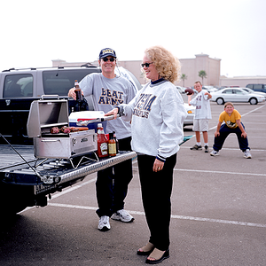 Solaire Anywhere being used at tailgate party (grill shown with older folding legs).