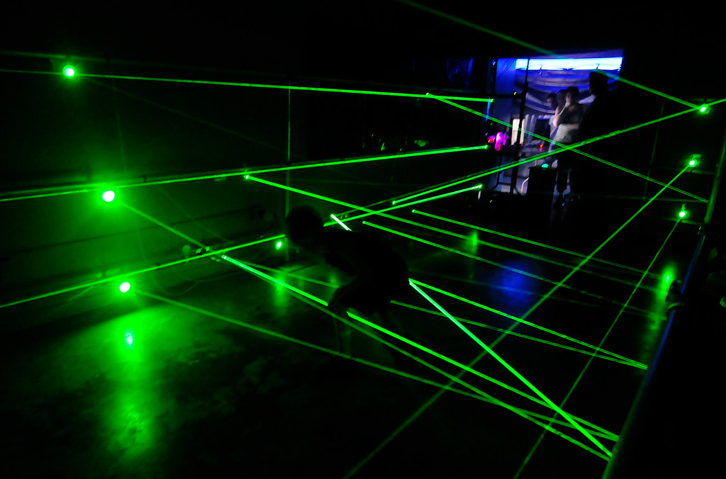 . VALLEJO, CA - JUNE 30, William Foley, 7, makes his way through the laser maze during the Mini Makers Faire inside the Solano County Fair on Saturday. (CHRIS RILEY/TIMES-HERALD)