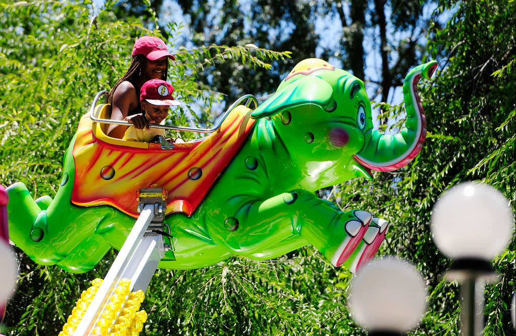 . VALLEJO, CA - JUNE 30, JFair goers fly in the elephant ride at the Solano County Fair on Saturday. (CHRIS RILEY/TIMES-HERALD)
