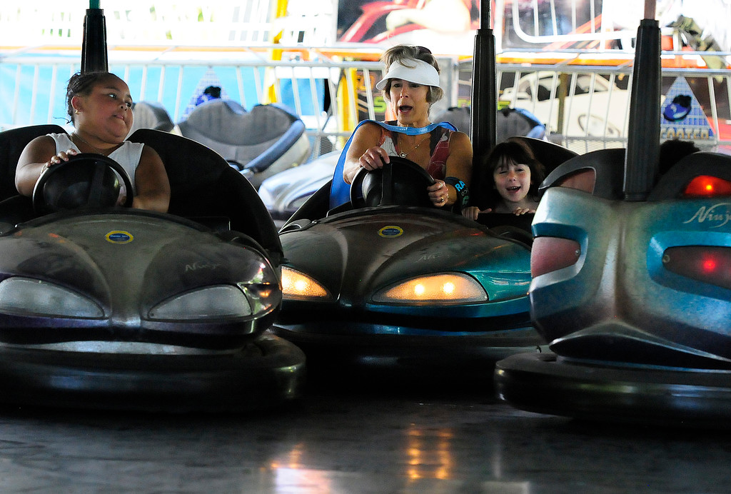 . VALLEJO, CA - JUNE 30, Kris Saad, of Benicia, with her grandaughter Gemma, 6, yell as they crash into another driver on the bumper cars at the Solano County Fair on Saturday. (CHRIS RILEY/TIMES-HERALD)