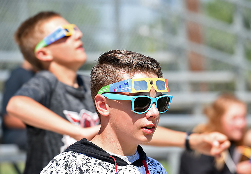 William Rogers, 13, a Bill Reed Middle School student, sports his sunglasses and his protective glasses Monday, Aug. 21, 2017, while getting ready to watch the solar eclipse at the school in downtown Loveland.  (Photo by Jenny Sparks/Loveland Reporter-Herald)
