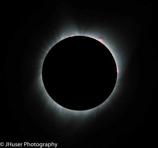 Red solar prominence showing during total eclipse