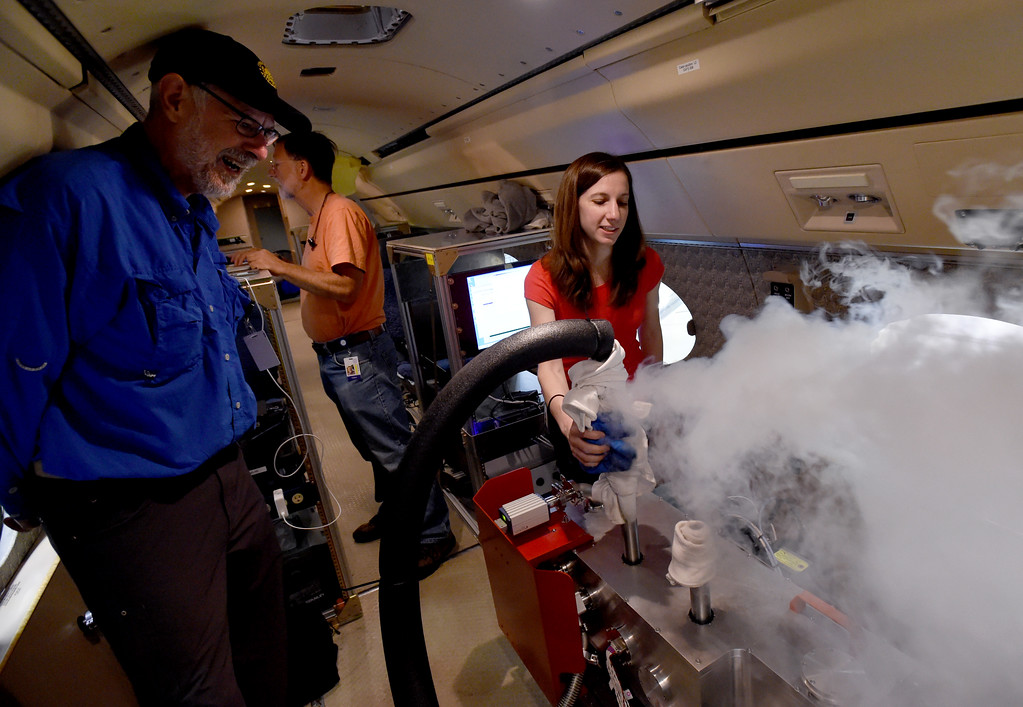 . Principle investigator, Ed DeLuca, left, Peter Cheimets, and Jenna Samra, work to prepare the aircraft for the upcoming solar eclipse tracking. Liquid nitrogen is used to cool the tracking instrument. An NCAR research team is going to be using its Gulfstream-V research aircraft during the total solar eclipse on Aug. 21, to take infrared measurements for about four minutes, which will help scientists better understand the solar corona\'s magnetism and thermal structure. . For more photos and a video, go to dailycamera.com.  Cliff Grassmick  Staff Photographer August 8, 2017