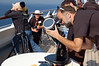 People setting up telescopes