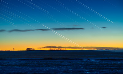 Planet Trails of Jupiter and Saturn Setting