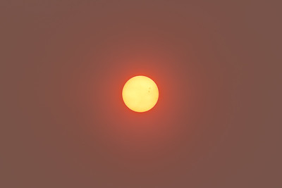The Sun in Smokey Skies