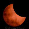 Cloudy crescent sun