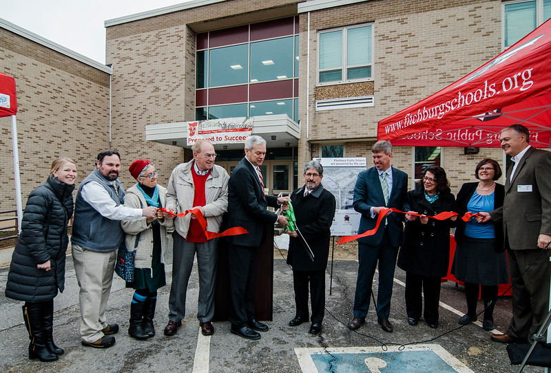 Superintendent of Schools Andre Ravenelle and Mayor Stephen DiNatale lead a ribbon cutting on a solar panel installation at Reingold Elementary School in Fitchburg, kicking off the school's clean energy activity day on Wednesday, April 5, 2017. SENTINEL & ENTERPRISE / Ashley Green