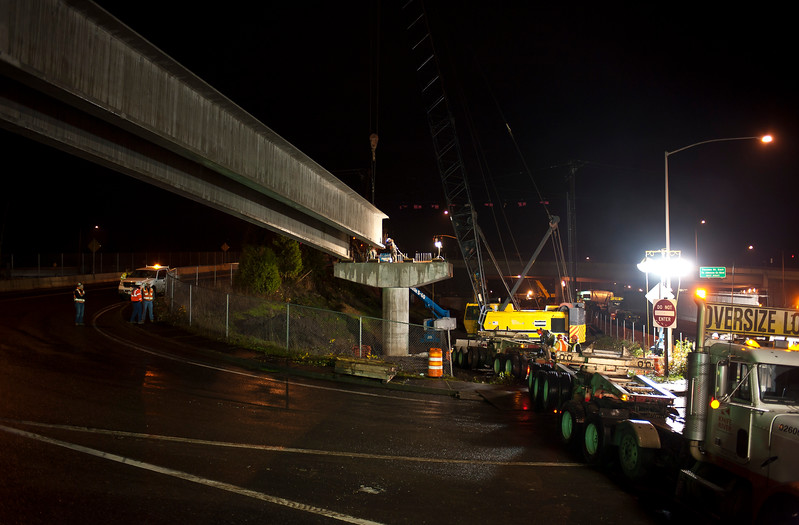 "Workers from Capital Concrete, Axis Crane and Stacey and Witbeck and others closed the Tacoma Street offramp from Northbound McLoughlin Blvd Friday night 12/7/12. During the closure they installed a span of 4 girders, each weighing more than 100,000 lbs and measuring about 140 feet in length. © 2012 TriMet / Fred Joe /  <a href=""http://www.fredjoephoto.com"">http://www.fredjoephoto.com</a>"