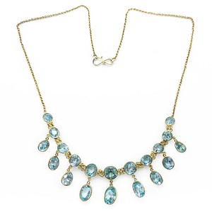 https://www.claricejewellery.com/product/vintage-art-deco-blue-zircon-faceted-drop-silver-gilt-chain-necklace