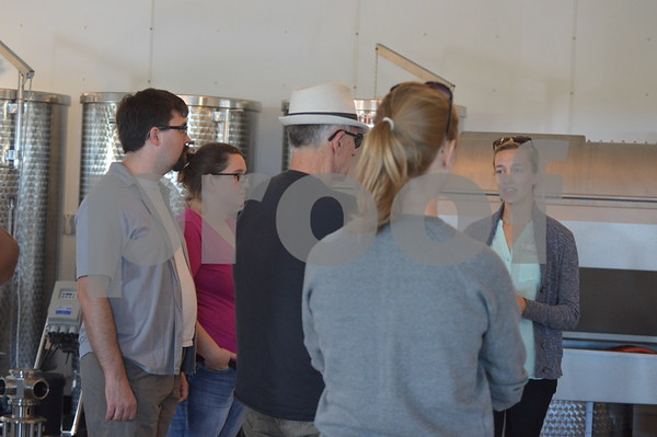 A winery employee gives guests of the festival a free tour of the building.