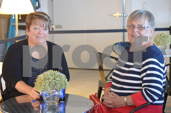 Kay Arends and Sandra Jordison enjoy a drink together at the festival.