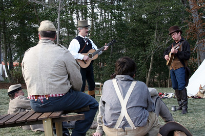 Wandering musicians provide some camp entertainment.