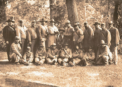 "Union ""Trophy Photo"" taken of the 3rd VA Volunteer Infantry at Gettysburg (2006).  This type of photo was customarily taken of captured Confederates to use for propoganda and to notify family members of the disposition of their missing loved ones.  Notice the rather authentic unhappy expressions of these captured soldiers."