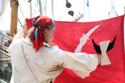 Alpheus explains Christopher Moody's flag.