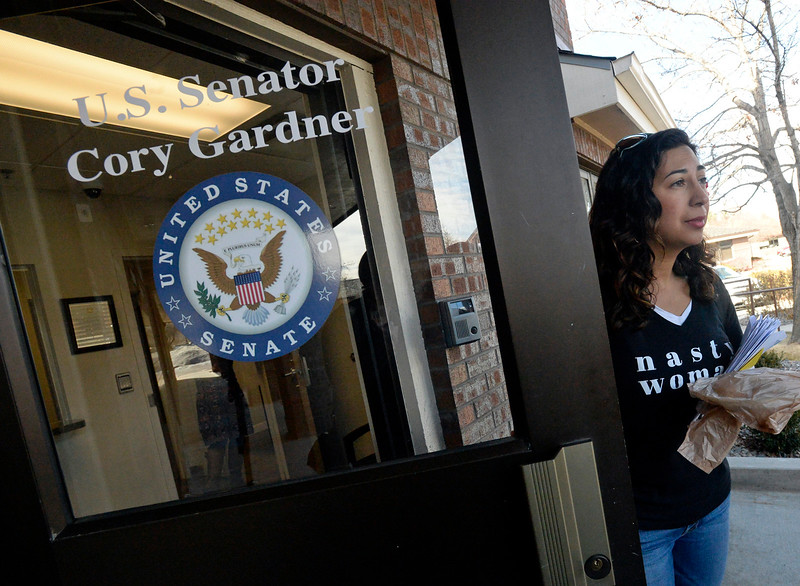 Patricia Miller, one of the organizers of the Marching in Solidarity with Our Immigrant and Muslim Neighbors event, drops off petitions, letters and postcards to U.S. Sen. Cory Gardner's office after the rally Tuesday, Jan. 31, 2017, in Fort Collins.   (Photo by Jenny Sparks/Loveland Reporter-Herald)