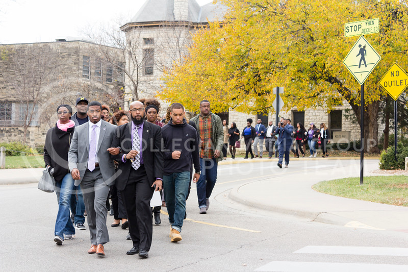 Darrell Reese Jr and Brandon L Clark lead the Black Student Union at Kansas State and the Big XII Council on Black Student Government to the front lawn of Anderson Hall for the Solidarity Rally on Nov . 4, 2017. (Alex Shaw | Collegian Media Group)