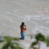 some dude on his cell phone in the water....tulum beach