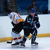 Adam Robinson and Bob Chalmers battle on the boards as Whitley Warriors photographer Colin Edwards watches in the background