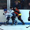 Bob Chalmers battles for possession with Rick Ravey on the boards