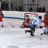 ... and the puck slips to safety