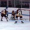 ... and the puck is diverted across the face of goal
