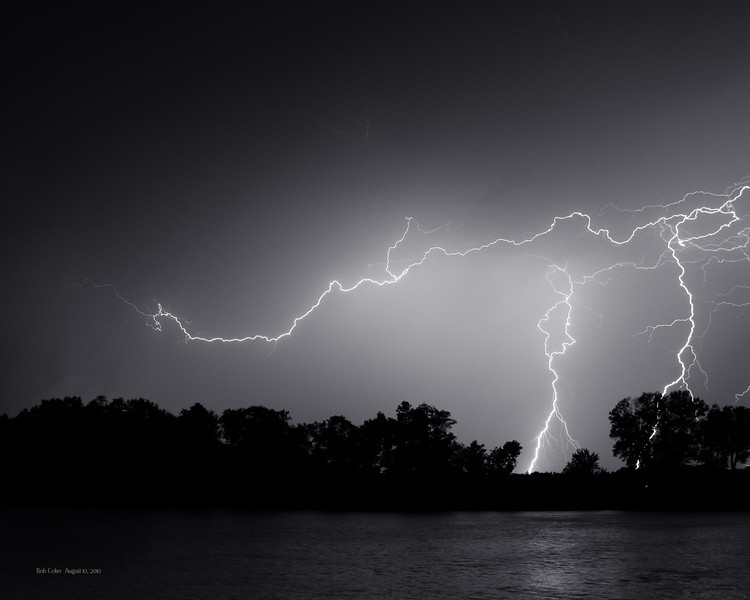 I enjoy seeing light and trying to capture it.  These next few lightning photos were taken August, 10, 2010.  I was shooting across the Illinois River.