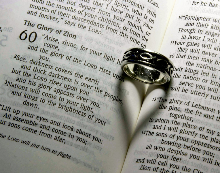 """His Word Never Changes!""  Some people miss the shape of the shadow given off by the ring."