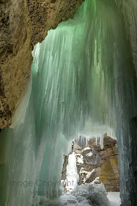 Frozen waterfall in Maligne Canyon, near Jasper Alberta, from behind.