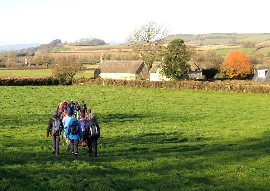 The group of 14 walks towards cottages on Spyway Road