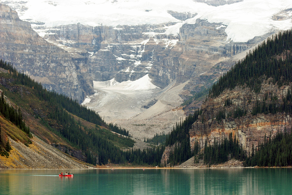 3 men in a boat [Lake Louise, Banff National Park, Alberta, Canada]