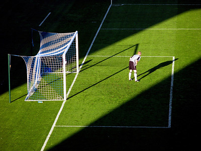 'Standing in the light' - Wigan keeper Chris Kirkland keeps goal during a sunny spell at the DW Stadium