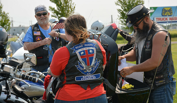 Among those gathering at The Cross is rider facing the camera,  Dave Trayler of Oakland City, Indiana and Rae Ann Brock with Alan Brock, also of Oakland City, Indiana. Alan Brock is the a national evangelist and a member of Chapter 112 Road Riders for Jesus. Dawn Schabbing photo