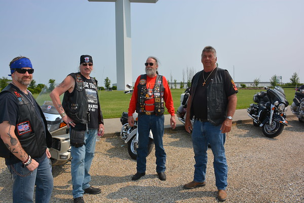 Four Road Riders for Jesus members visit at The Cross in Effingham Saturday morning in its annual Son Rise Ride. Bikers in the motorcycle ministry come from a few states away to gather, worship and spread the Gospel. Shown from left are: Bryan Petrowsky of Decatur, Terry Fowler of Shelbyville, Don Lasher of Carmel, Indiana, and Wayne Steele of Lakewood. Dawn Schabbing photo