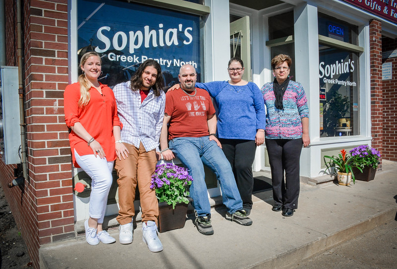 From left, Magi, Kostas, George, Valerie, and Sophia Georgoulopoulos stand outside of Sophia's Greek Pantry in Lowell. SUN/Caley McGuane