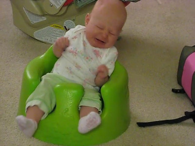 She isn't always happy in the bumbo, and she can almost throw herself out of it.