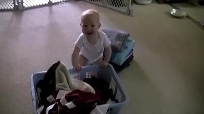 Sophie pushing the laundry basket