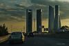 """15-09-2009  """"Cuatro Torres Business Area, Madrid"""" - Si, lo sé, lo sé y lo sé. No es una buena foto en muchos aspectos. Pero teniendo en cuenta que iba conduciendo, que al incorporarme a la M-30 vi que 'podía haber foto', que evidentemente no podía pararme, que no podía soltar el volante, como pude quité la tapa del objetivo (la cámara iba en el asiento de al lado), hice un poco de zoom, la encendí y con una solo mano y sin poder mirar por el visor ni hacer ningún ajuste, hice la foto. No ha salido bien enfocada, tuve que nivelarla un poco y aclarar sombras. Pero aún teniendo en cuenta todo esto, creo que para una 'sopita' puede valer. ¿ O no? ;-) Más información sobre las cuatro torres <a href=""""http://es.wikipedia.org/wiki/Cuatro_Torres_Business_Area"""">AQUI</a>.  Nota: Ayer dije que publicaría una galería con fotos de la Romería de San Lorenzo de El Escorial, <a href=""""http://www.rancho-k.com/Mas-recientes-Most-recent/Romer%C3%ADa-San-Lorenzo-2009/9642317_SR6ws#650384816_uJTHv"""">ESTA ES</a>   """"Four Towers Business Area, Madrid"""" - Yes, I know, I know and I know. It is not a good picture at all in many aspects. But accounting that I was driving, that when getting to the M-30 I saw that there could be a shot, that I evidently could not stop, that I could not let the steering wheel loose, I managed to remove the lens lid (the camera was on the seat next to me), zoom in a little, turn it on and, with only one hand and not being able to look through the viewfinder or make any adjustments, I took the shot. It doesn't have good focus, I had to rotate (level) it and clear some dark shadows. But even accounting for all of that, I think it does still make a good 'soup'. Don't you agree? ;-) More information about the four towers <a href=""""http://en.wikipedia.org/wiki/CTBA"""">HERE</a>.  Note: Yesterday I said I would publish a gallery for the Romeria of San Lorenzo, <a href=""""http://www.rancho-k.com/Mas-recientes-Most-recent/Romer%C3%ADa-San-Lorenzo-2009/9642317_SR6ws#650384816_uJTHv"""""""